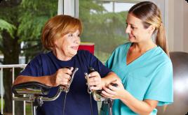 caregiver assisting senior woman in walking