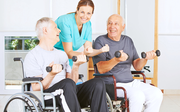 caregiver assisting two senior man in exercising